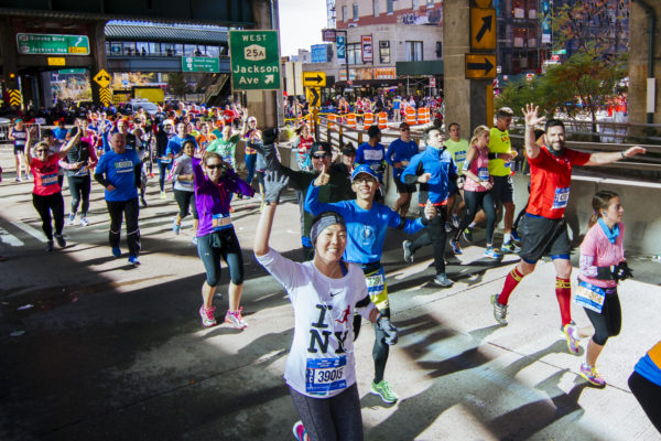 Runners enter the Queensboro Bridge en route to Manhattan in the 2014 TCS New York City Marathon. (Credit: Courtesy NYRR)