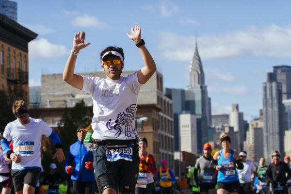 Runners pass the Midtown skyline in Queens about halfway through the 2014 TCS New York City Marathon. (Credit: Courtesy NYRR)