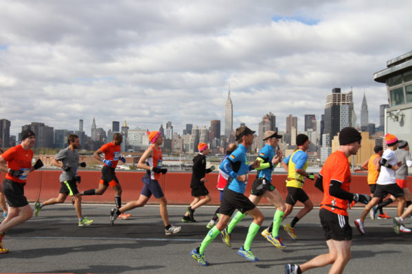 Runners cross from Brooklyn to Queens, halfway through the 2014 TCS New York City Marathon. (Credit: Courtesy NYRR)