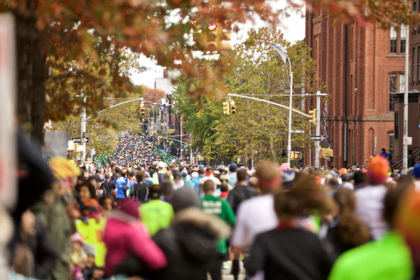Runners and spectators pack the streets of Brooklyn in the 2014 TCS New York City Marathon. (Credit: Courtesy NYRR)